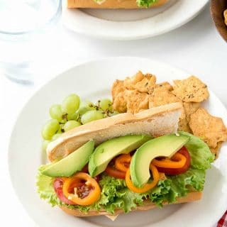 2 plates with Southwestern Sub Sandwiches full of chipotle mayonnaise, turkey, fresh vegetables, and pepper jack cheese.