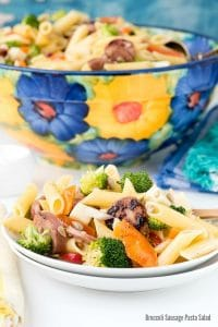 white plate with a serving of Broccoli Sausage Pasta Salad