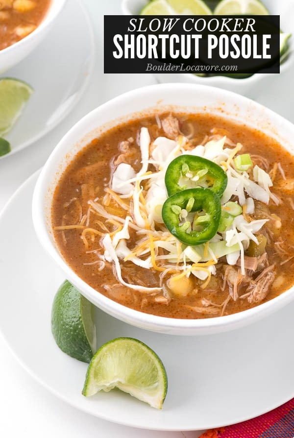 Posole in a white bowl with toppings title