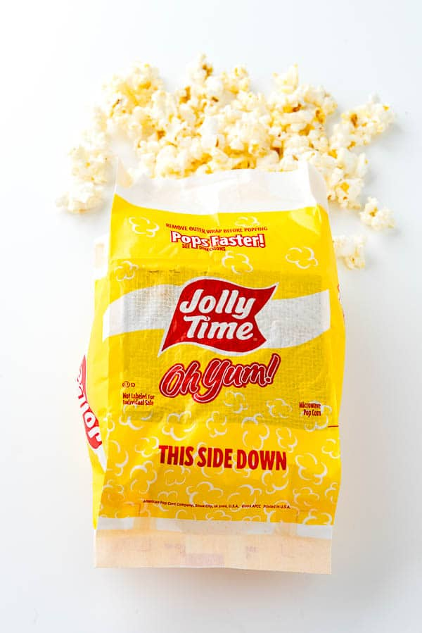 an open bag of popped microwave popcorn for smart snacking
