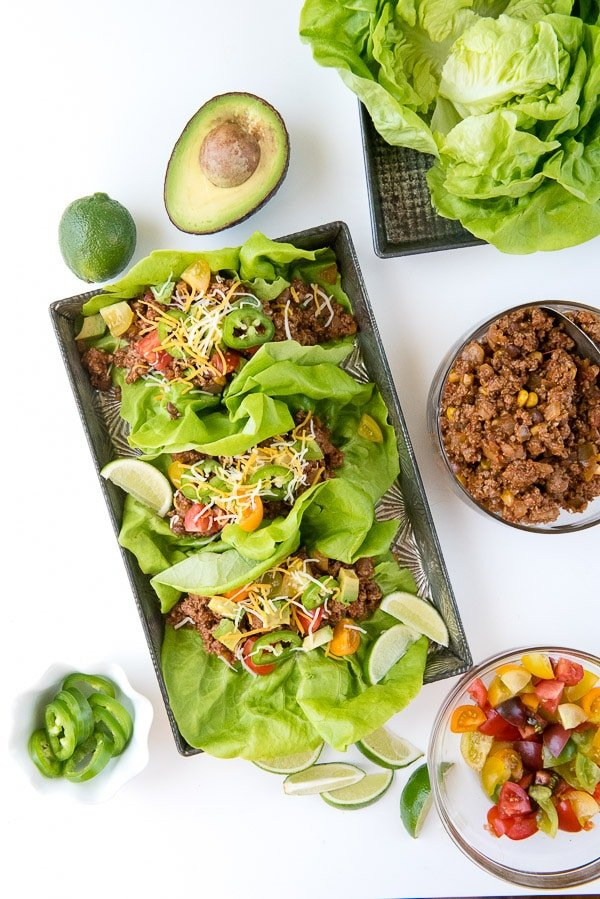 A platter of lettuce wraps with taco filling