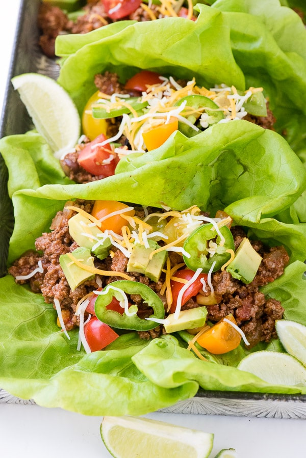 Two taco lettuce wraps with toppings