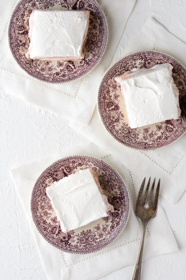 Fluffy No-Bake Strawberry 'Cheesecake' Dessert Lasagna recipe. A luscious four layered dessert with cookie crust, cream cheese, custard and whipped topping with strawberry flavors. Light as a cloud! Both gluten-free and gluten versions. - BoulderLocavore.com