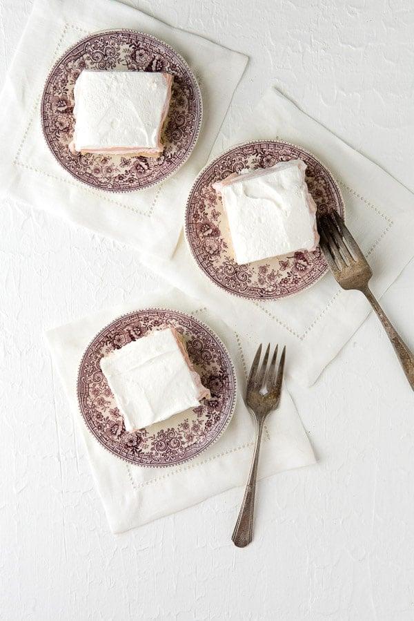 overhead image of 3 plates of Fluffy No-Bake Strawberry Cheesecake Dessert Lasagna