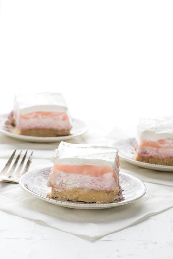 layered strawberry cheesecake dessert on a plate