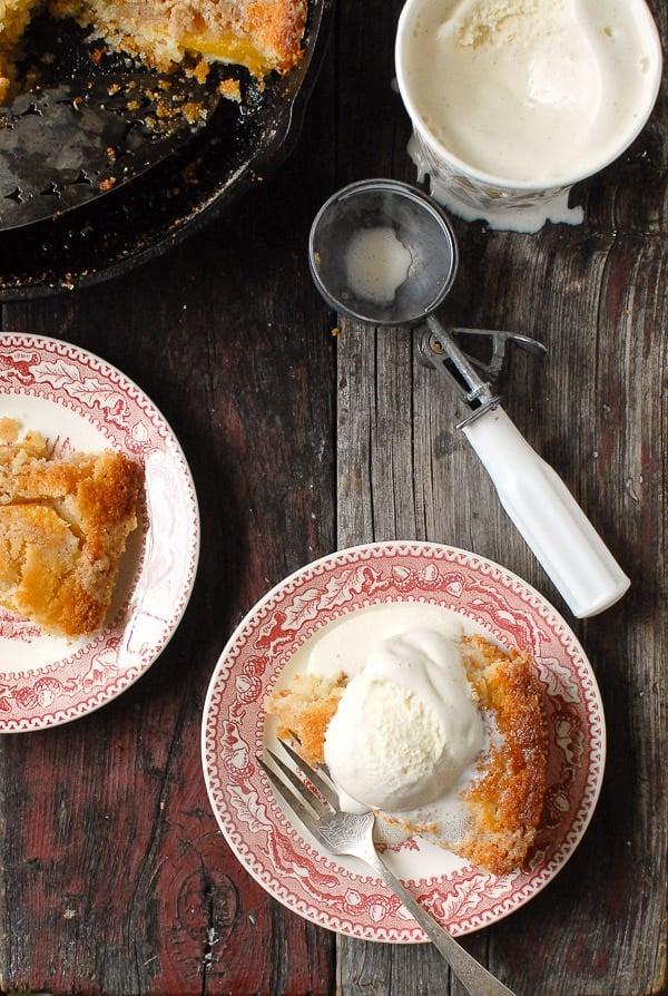 servings of  Buttermilk Peach Buckle with vanilla ice cream