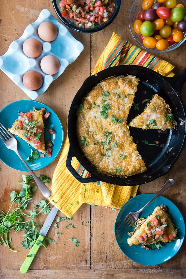 Cheesy Mexican Frittata. A super-quick meal full of Mexican taco seasonings, green chilies, jalapeno slices and fantastic cheese! Topped with fresh pico de gallo it is a great fast recipe for dinner or brunch. - BoulderLocavore.com