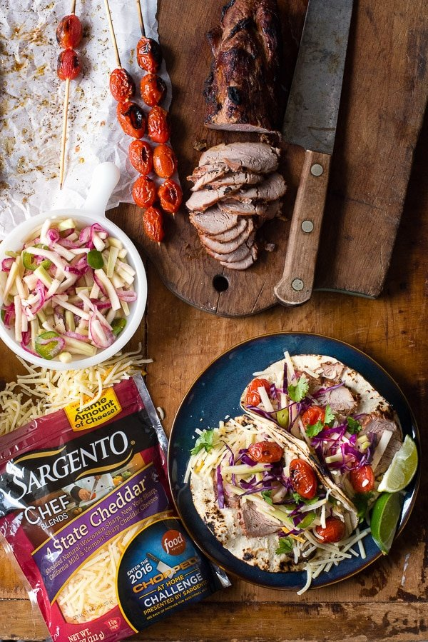 Grilled Pork Street Tacos with Pickled Broccoli Stem Slaw and Blistered Tomatoes. An easy street taco recipe bursting with big flavors thanks to grilled pork tenderloin, a crunchy quick pickled slaw and sweet grilled tomatoes. All components can be made solo too for other meals. - BoulderLocavore.com
