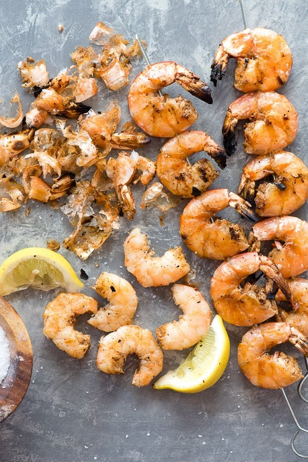 Grilled Spicy Salt and Pepper Shrimp Skewers with some unpeeled grilled shrimp