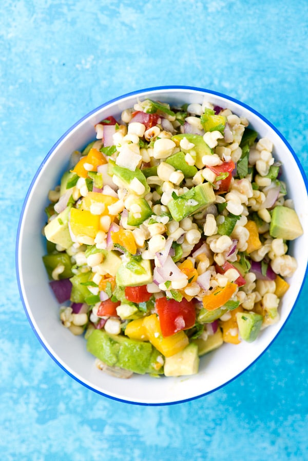 Corn Salsa with fresh vegetables in a blue bowl