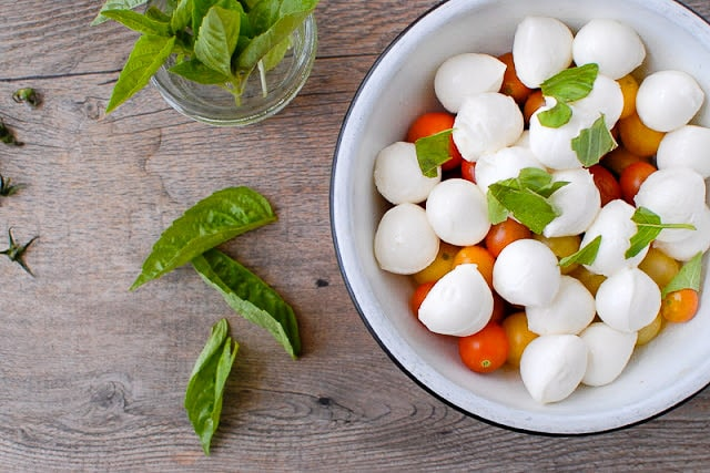 Bite-size Insalata Caprese with ingredients