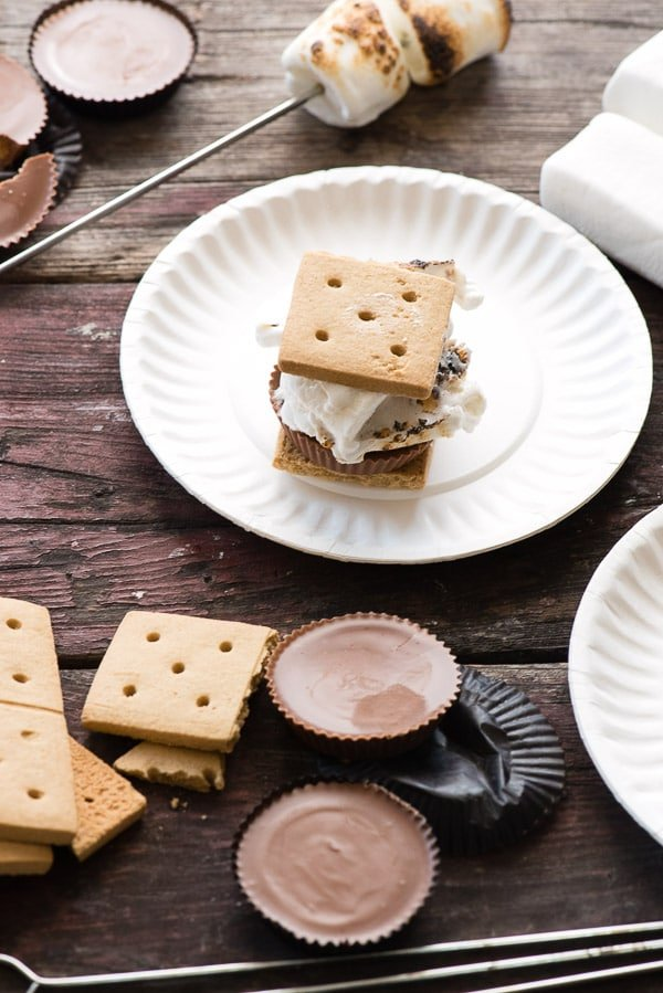 Peanut Butter Cup S'Mores. Didn't think it was possible to improve on the iconic summer campfire dessert? You'll fall in love with gooey roasted marshmallows, a peanut butter cup and graham crackers! Can't eat nuts? Sunflower butter cups are a great option. - BoulderLocavore.com