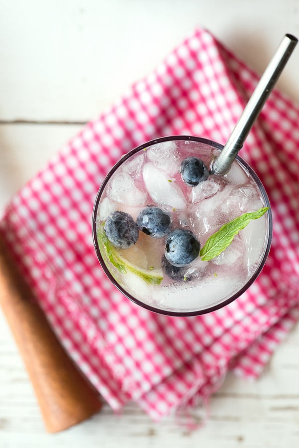 Blueberry Mojitos. A delicious seasaonal cocktail recipe with muddled fresh mint, lime juice, fresh blueberries and rum. For those not wanting the liquor, there is a faux-jito recipe option too! - BoulderLocavore.com