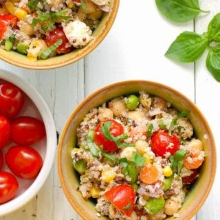 Rainbow Quinoa Summer Salad (quinoa). This colorful chilled salad recipe is packed with nutrition and fresh flavors of summer. It can be prepared in less than 30 minutes (with a bit more time for chilling) and is perfect with grilled meats or to go for picnics! - BoulderLocavore.com