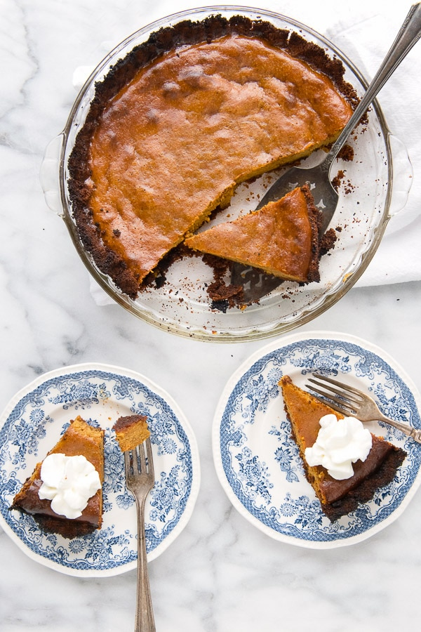 Grilled Pumpkin Pie with Hickory-Smoked Ginger Snap Crust in pan and on plates