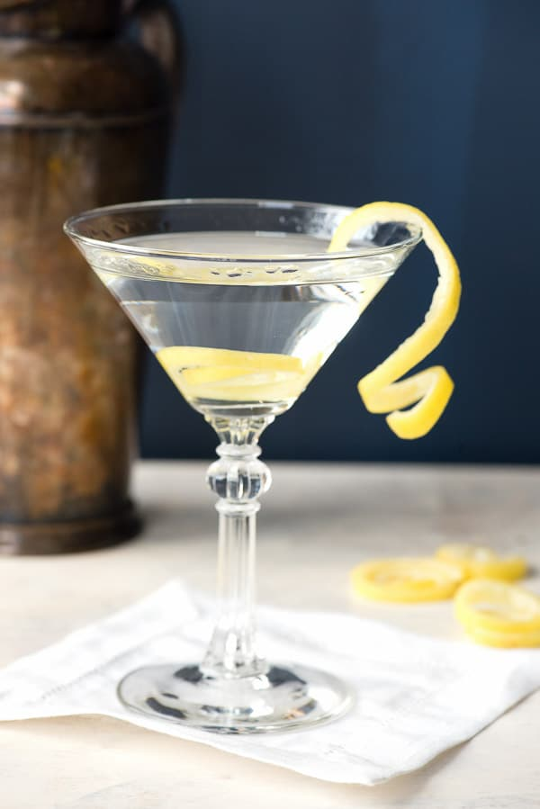 side view of cocktail glass with lemon spirals garnish