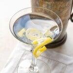 lemon curls on cocktail glass - titled image