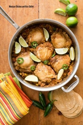 Mexican Chicken and Rice Skillet in a large skillet on wooden cutting board