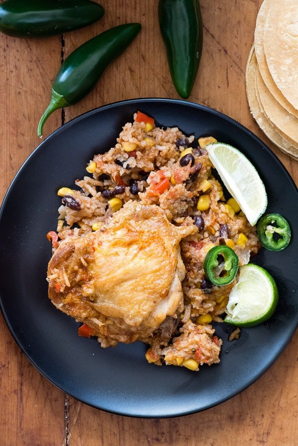 single serving of spicy Mexican Chicken and Rice Skillet on a black plate