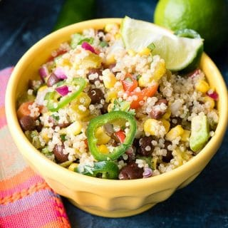 Mexican Quinoa Salad wtih lime wedge in yellow bowl