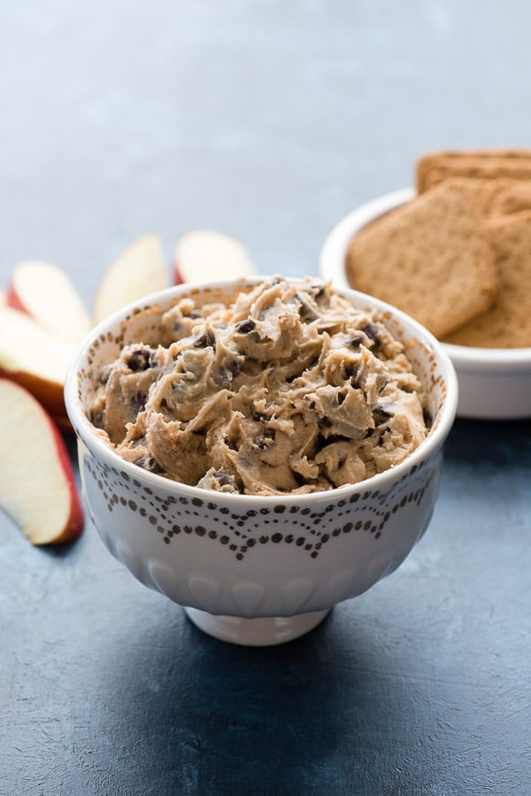 Pumpkin Spice Cookie Dough Dip in a decorative bowl with cookies and apple slices