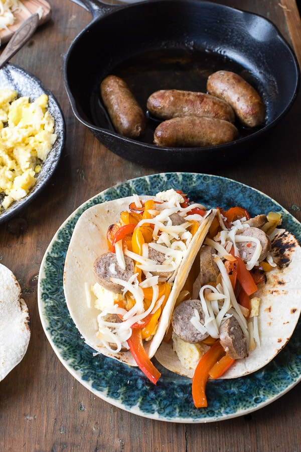 Sausage and Peppers Breakfast Tacos. A hearty start to the day with colorful bell peppers, onions, scrambled eggs, breakfast sausage and smoked cheese! | BoulderLocavore.com