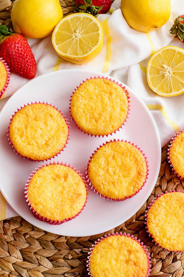 freshly baked lemon cupcakes in pink liners