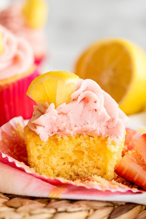 lemon cupcakes with strawberry frosting halved