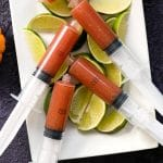 Bloody Maria Shots. A Bloody Mary made with tequila instead of vodka, these spicy shooters are perfect in a syringe for Halloween or shot glass for spicy sipping anytime! BoulderLocavore.com