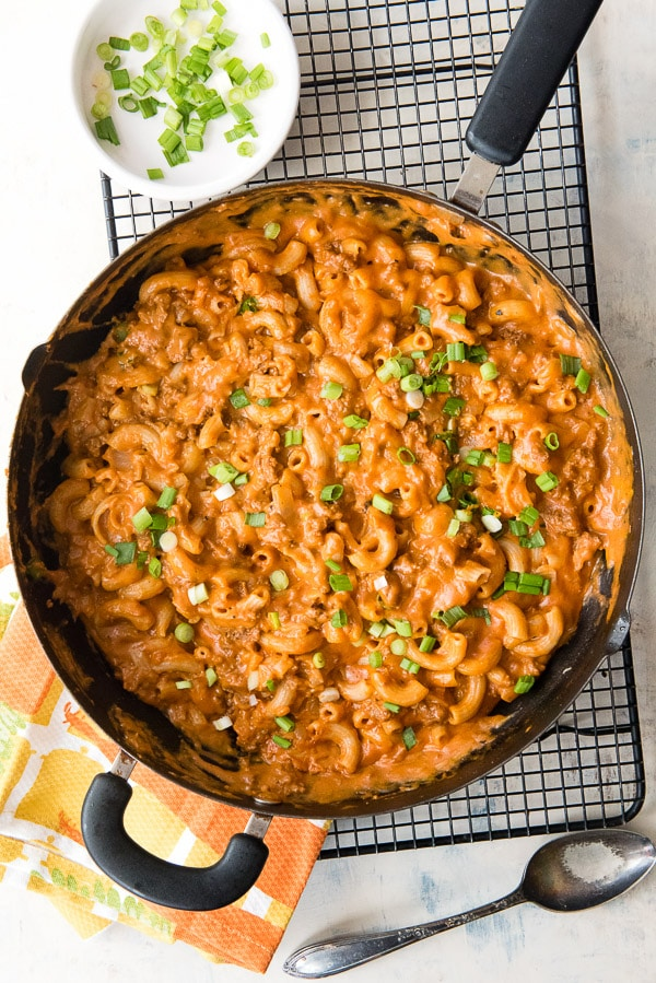 Homemade Hamburger Helper with cheesy tomato sauce in a large skillet