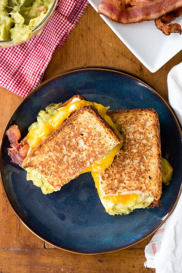 grilled cheese and bacon sandwich on blue plate