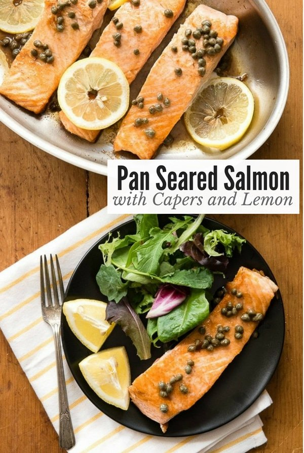 Pan Seared Salmon with Capers and Lemon in a pan and on a black plate