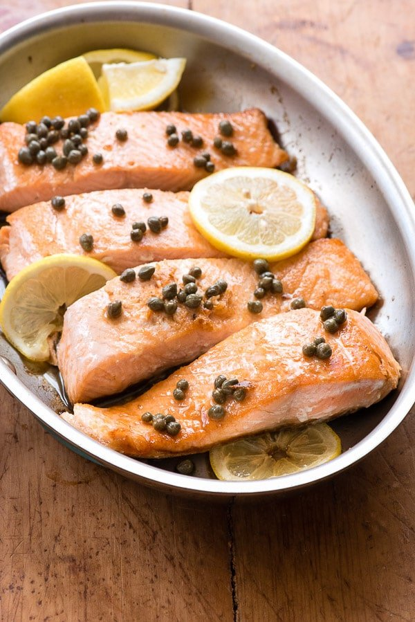 Pan Seared Salmon with capers and lemon in skillet