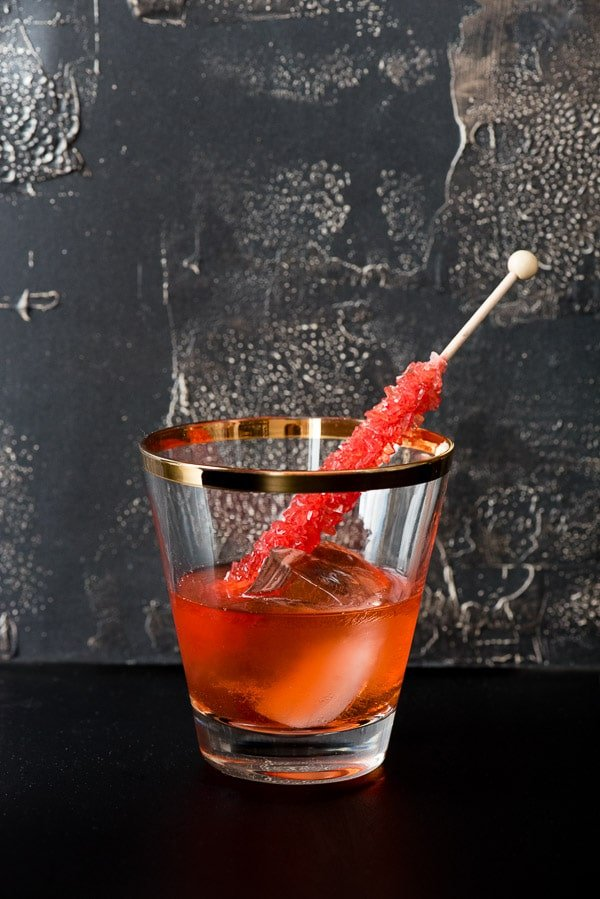 The Negan Cocktail (an Old Fashioned The Walking Dead style). Rye whiskey, bitters, rock sugar, splash of water and a creepy nod to the most disarming TV villain ever. BoulderLocavore.com