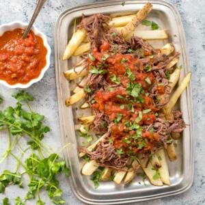carne asada fries with salsa close up overhead