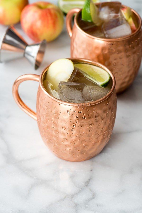 Apple Cider Moscow Mules. Vodka with lime wedges