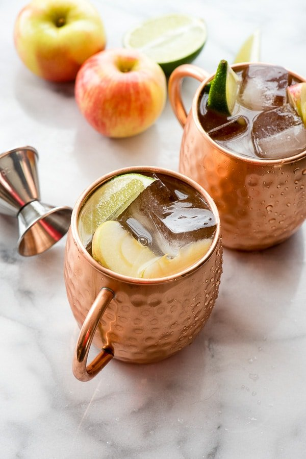 Apple Cider Moscow Mules with jigger and apples