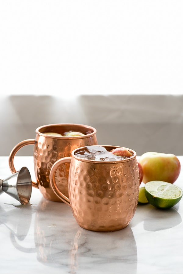 Apple Cider Moscow Mules. Vodka, hard cider, lime juice and ginger beer make this seasonal cocktail refreshing and great for any occasion. BoulderLocavore.com