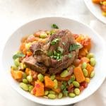 Instant Pot Short Ribs on bed of Harvest Succotash in white bowl