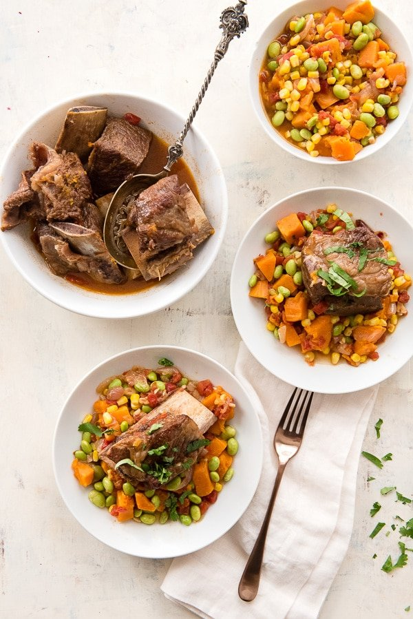 colorful harvest succotash with beef short ribs in bowls