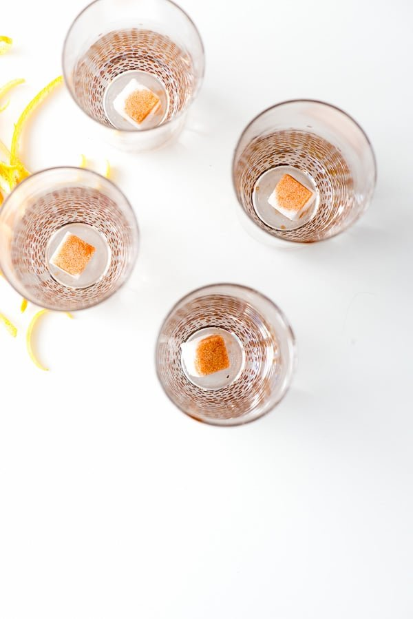 sugar cubes in a champagne glass doused with bitters