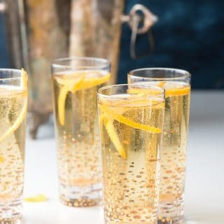 Assembled champagne cocktails with silver champagne bucket