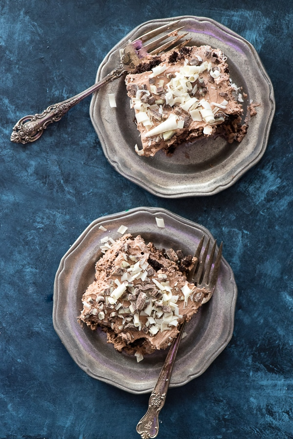 Fluffy Gluten Free Chocolate Mint Ice Box Cake. Three layers of deep chocolate cookies, billowy chocolate-mint filling, Andes mints and white chocolate curls. No baking! Gluten option. BoulderLocavore.com