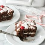 Fully Loaded Chocolate Peppermint 'Oreo' Brownies (gluten free or with gluten). Chocolate Brownies with white chocolate chips, sandwich cookies, chocolate ganache, mint M&M's and candy canes! BoulderLocavore.com