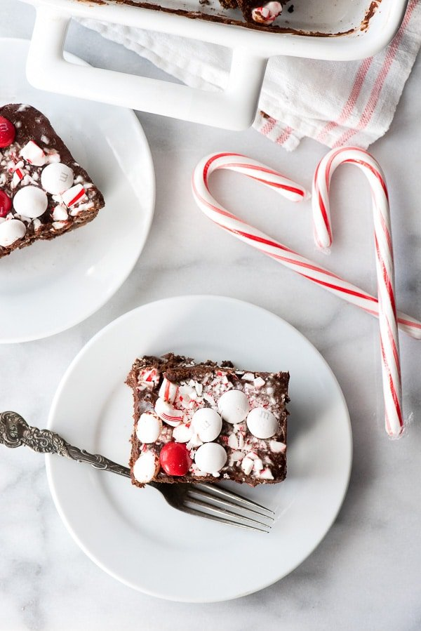 Fully Loaded Chocolate Peppermint Oreo Brownies (gluten free or with gluten). Chocolate Brownies with white chocolate chips, sandwich cookies, chocolate ganache, mint M&M's and candy canes! BoulderLocavore.com