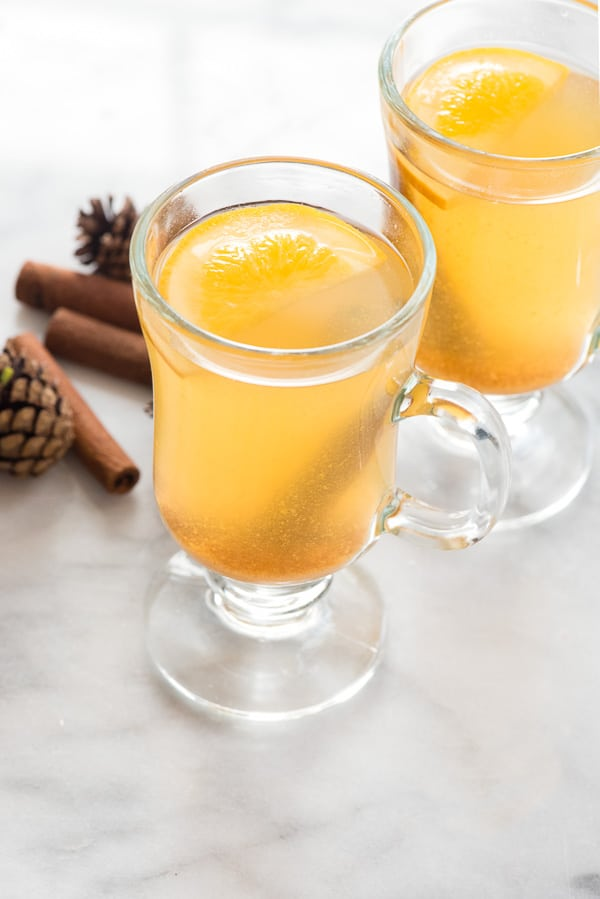 Slow Cooker Mulled Apple Cider in glass mugs with orange slices