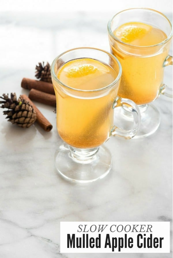 Mulled Apple Cider in glass mugs with cinnamon sticks