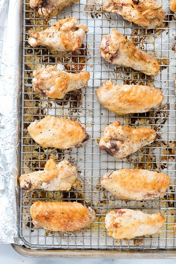 Lemon-Garlic Chicken Wings. Moist, juicy baked chicken wings with irresistibly crispy skin. Flavored with lemon, garlic, salt and pepper they are great for a crowd! Gluten-free. BoulderLocavore.com