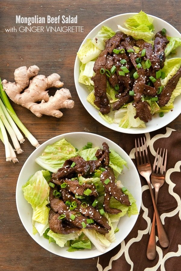 Mongolian Beef Salad with Ginger Vinaigrette. A quick stir-fry recipe for leaner Mongolian Beef tops crunchy, fresh romaine lettuce hearts and ginger vinaigrette dressing for a flavor-packed easy gluten-free recipe you'll love! - BoulderLocavore.com