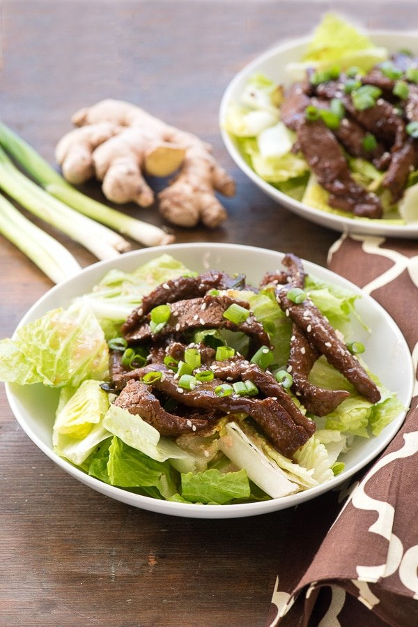 A plate of Mongolian Beef Salad with Ginger Vinaigrette.